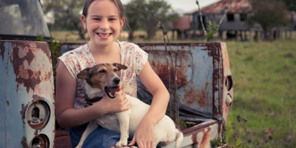 daughter_sitting_with_dog_on_car_2