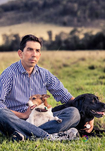 michael_with_dogs_in_field_sqr